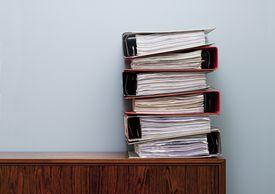 stacks of binders on a desk