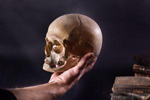 Holding the skull of Yorick from Hamlet