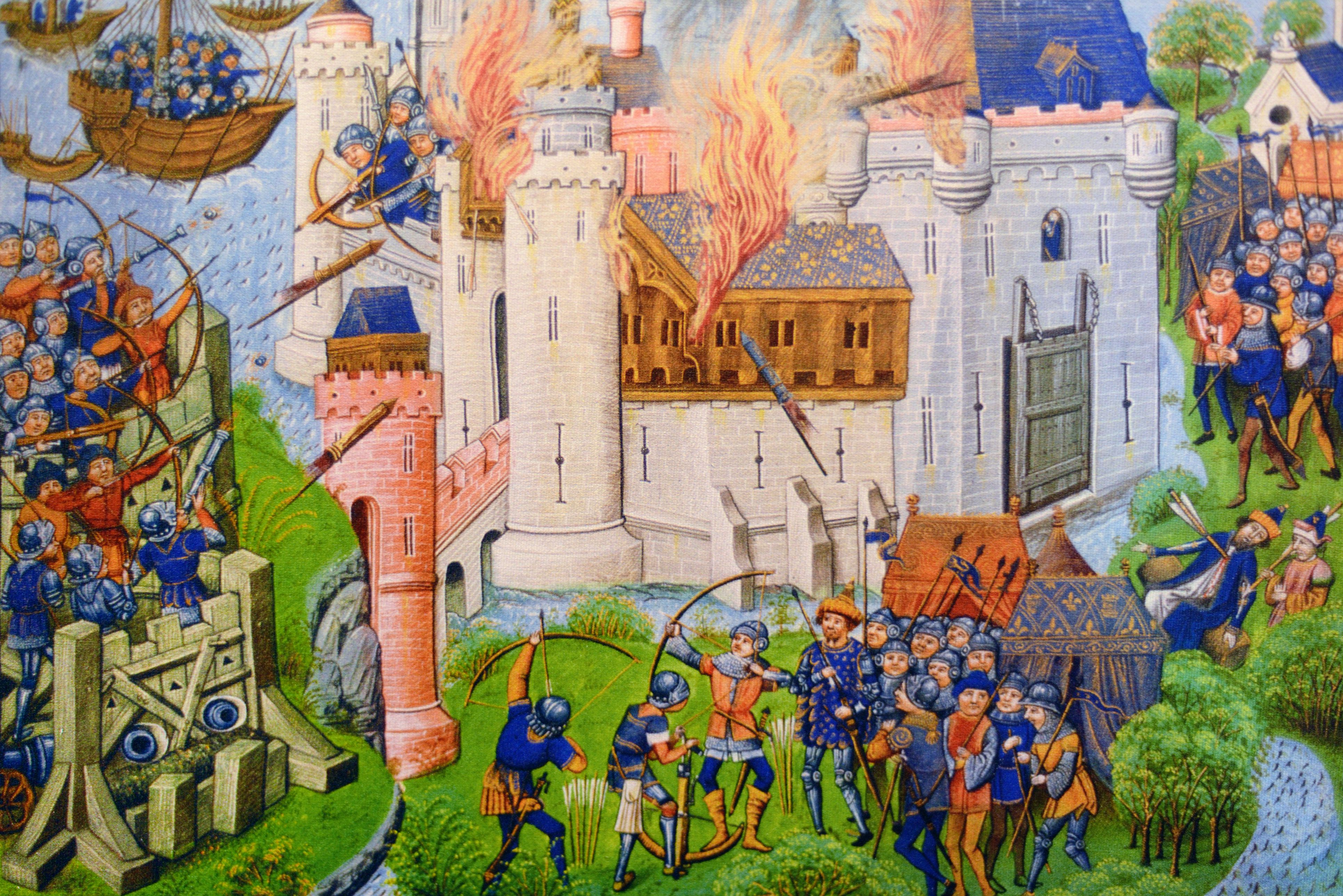 A battle scene and siege with incendiary rockets during the 100 Years War between Britain and France