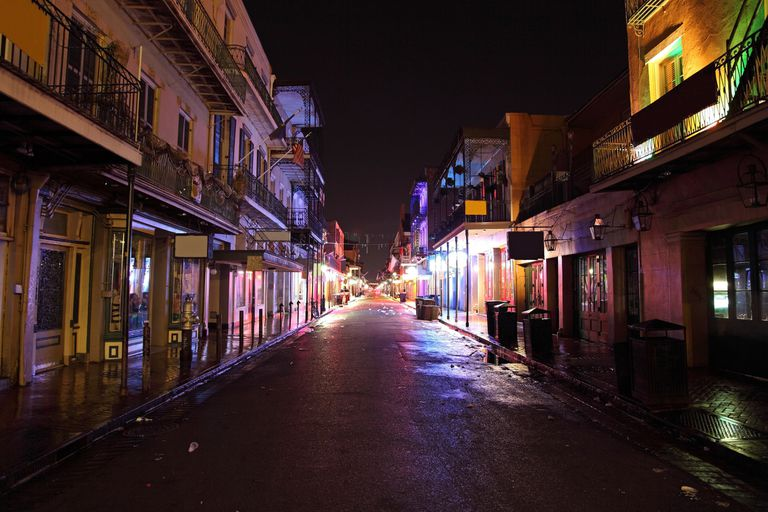 Bourbon Street in the French Quarter in New Orleans, Louisiana at night.