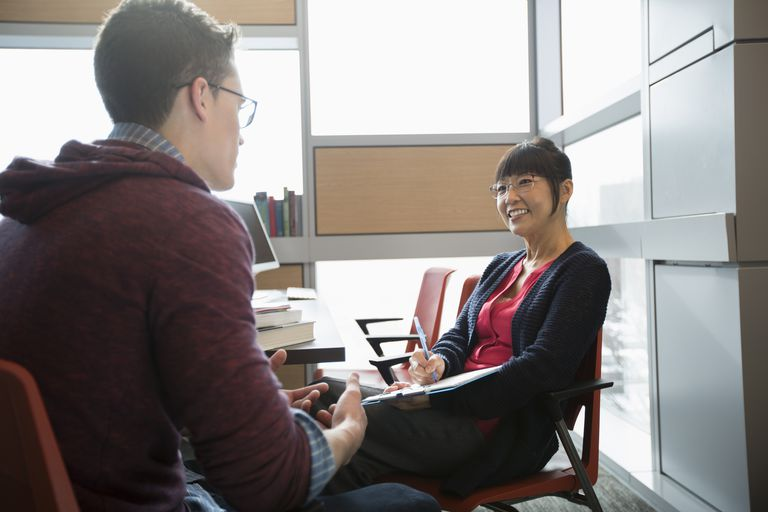 Professor meeting with a student in her office