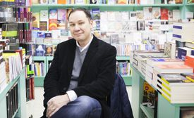 Jamie Ford, American writer, sits in book store, Milan, Italy, 18th April 2014.