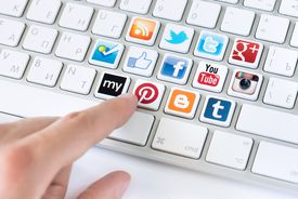 An image of social media icons on computer keyboard keys