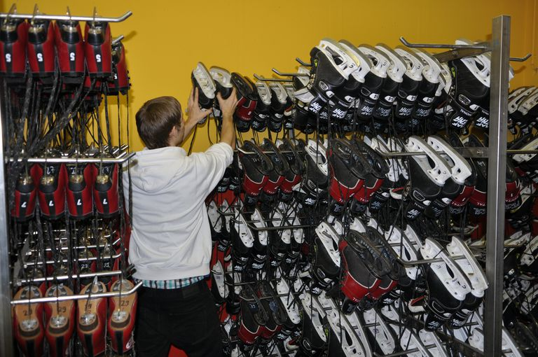 boy selecting ice skates
