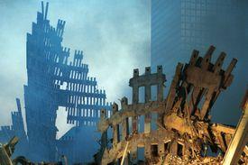 smoldering framework of fallen twin towers