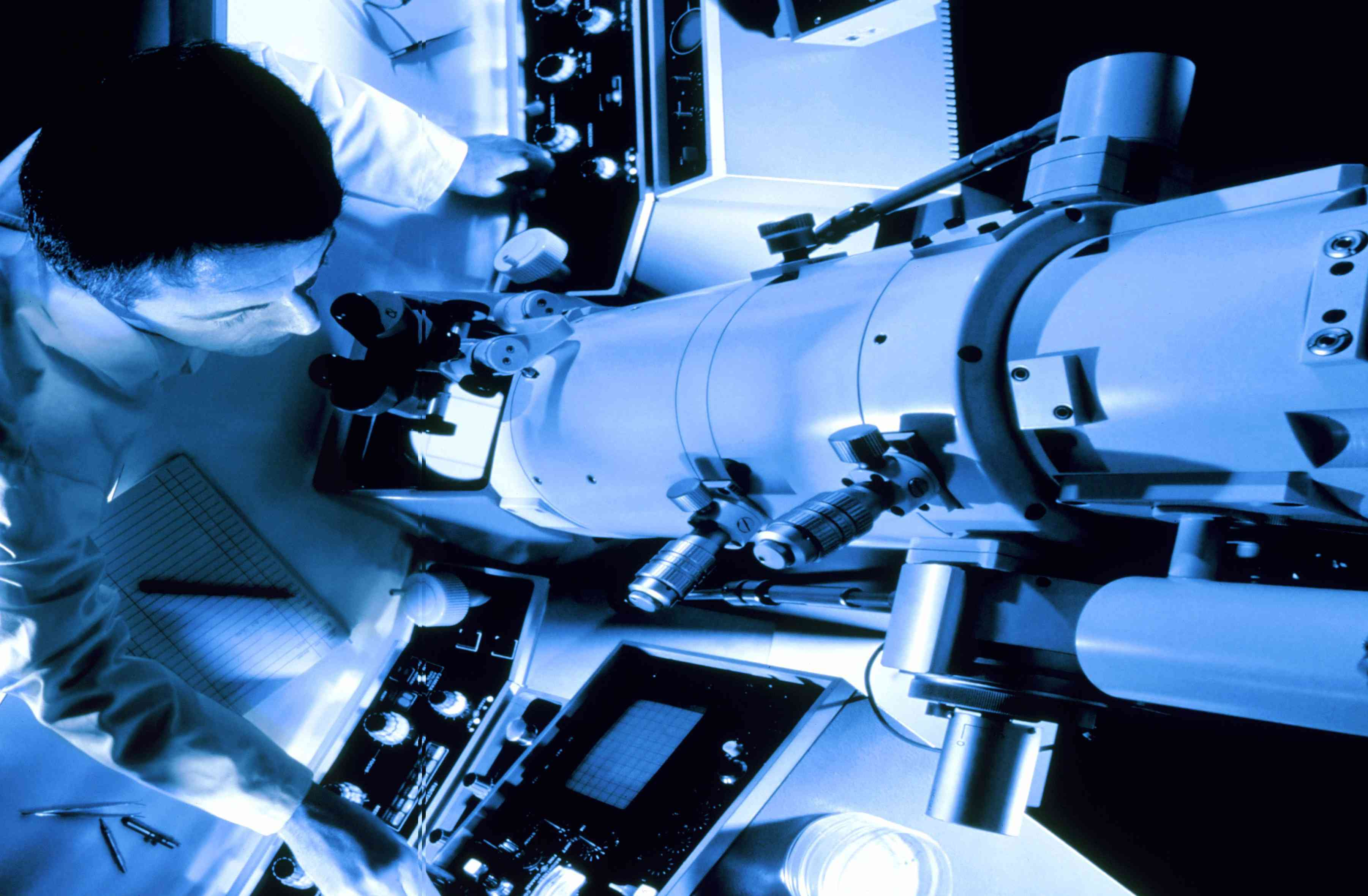 Aerial view of a person using an electron microscope.