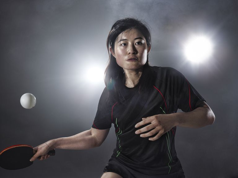 Asian woman playing table tennis