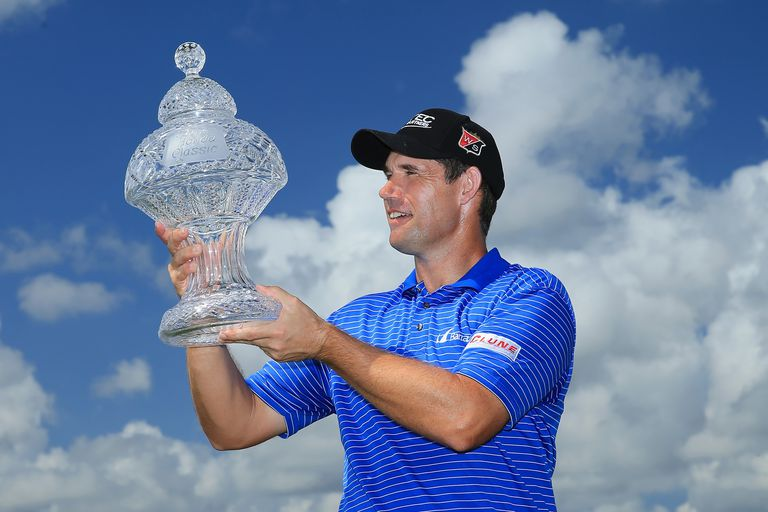 Padraig Harrington of Ireland poses with the trophy after winning the 2015 Honda Classic