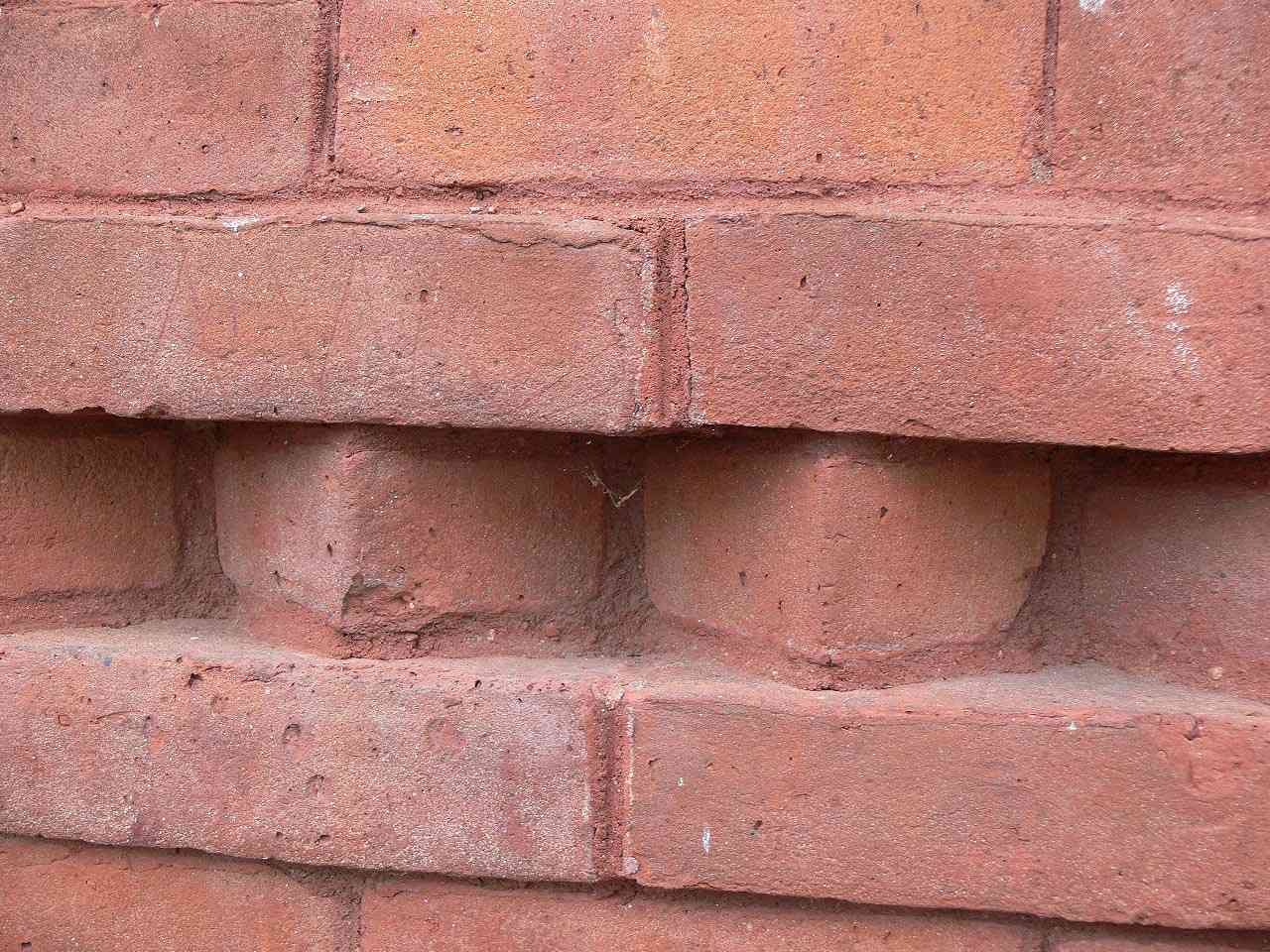 A row of bricks set at angles adds texture to the walls of Mark Twain's Connecticut home.