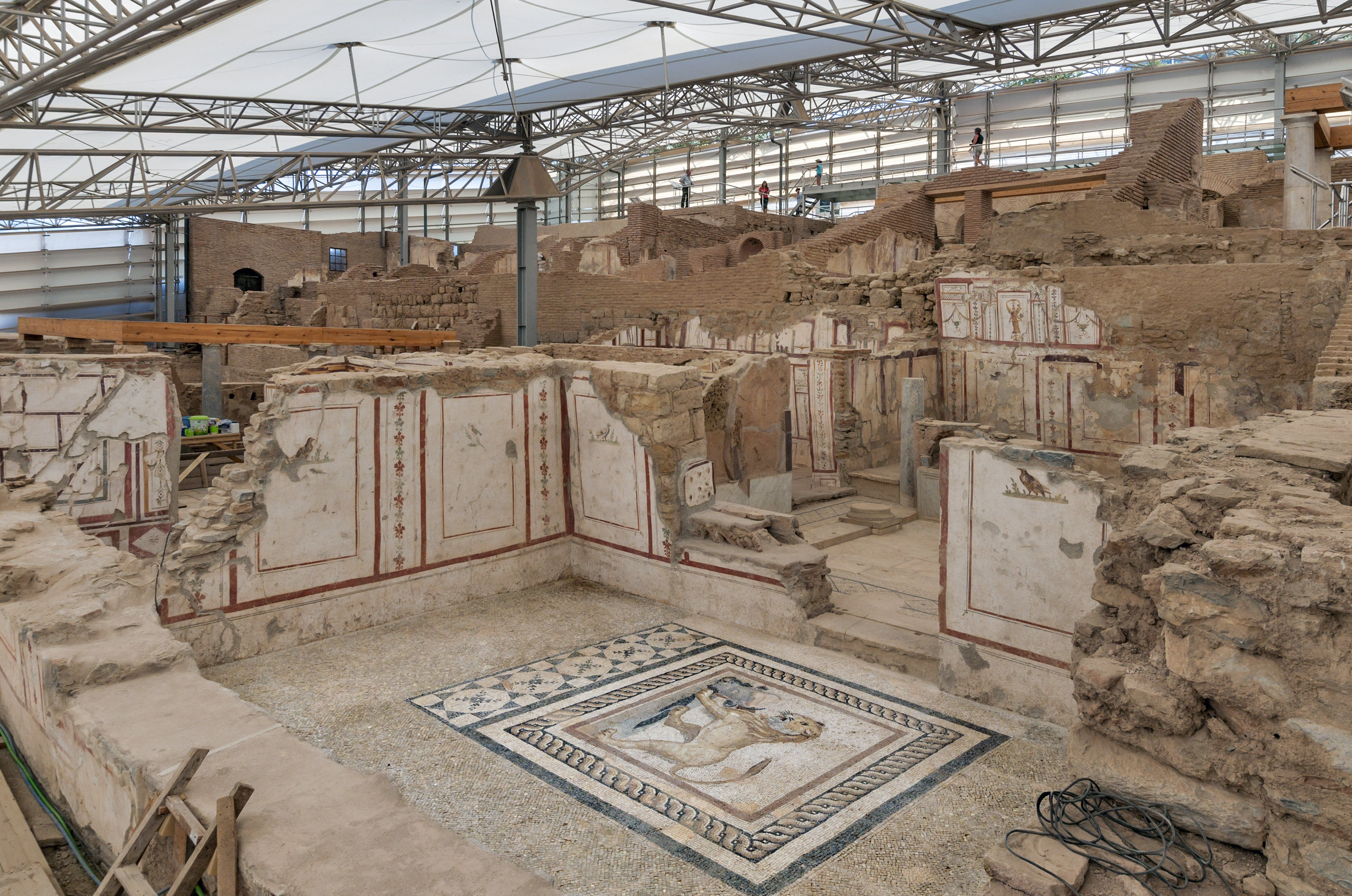 covered archeological site revealing mosaic flooring