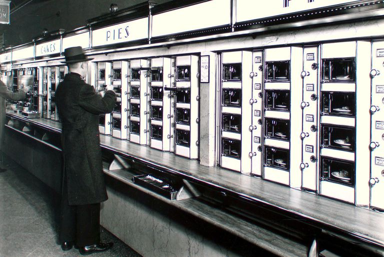 Man getting food at vintage automat