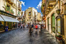 People walking down an Italian street.