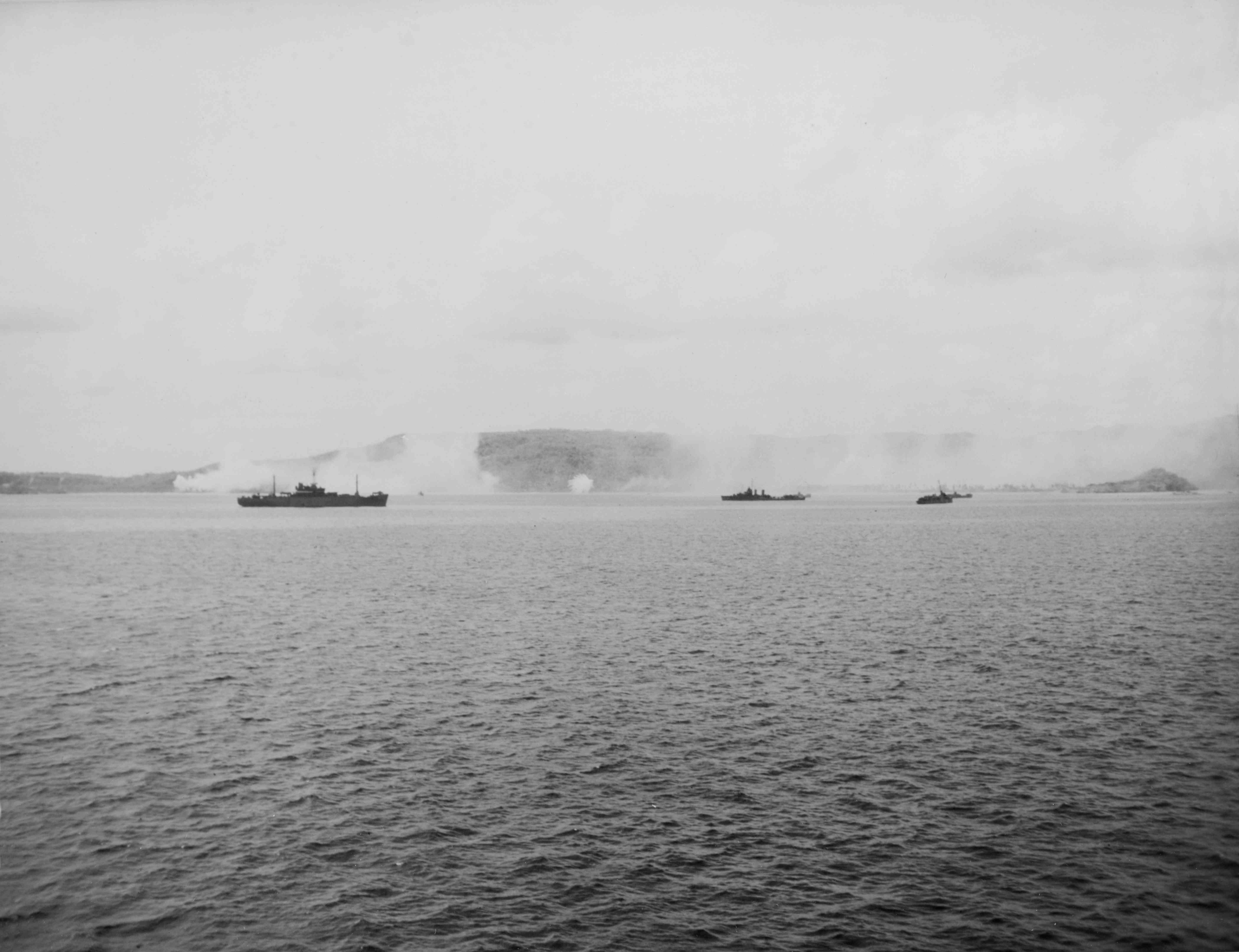 Allied warships firing at targets ashore on Guam.