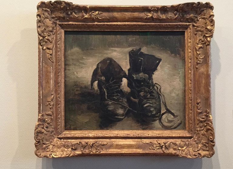 Painting of shoes in black and white by Vincent van Gogh