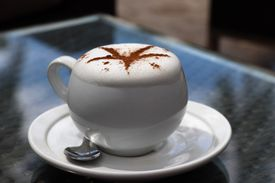 Coffee with foam on top.