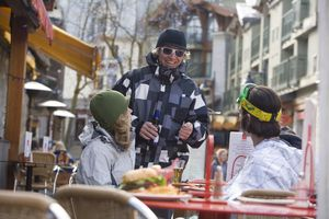 Young adults enjoy an after ski drink, Whistler Village, British Columbia, Canada