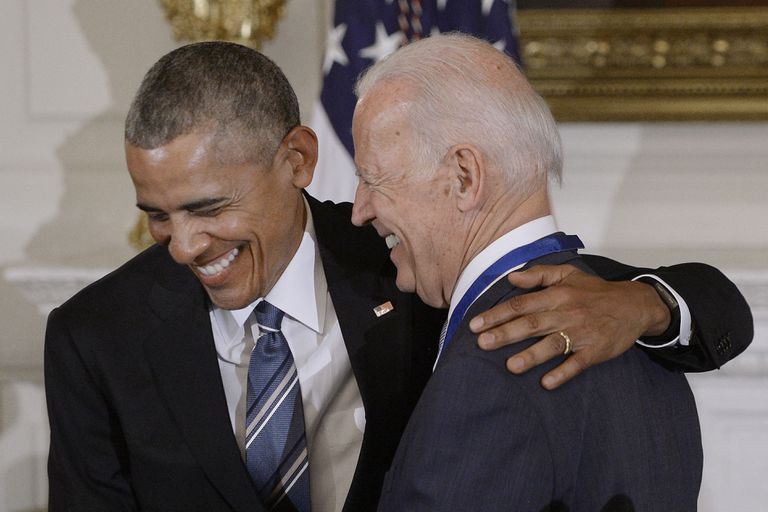 President Obama with his arm around VP Biden bth are smiling