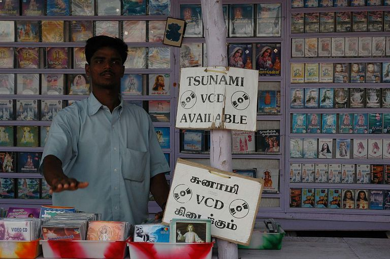 man selling goods after tsunami