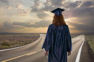 Graduate standing at crossroads