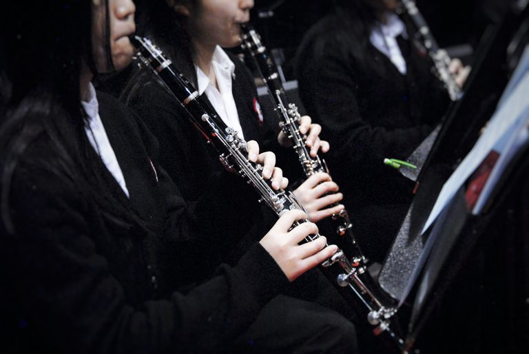 Midsection Of Women Playing Clarinet