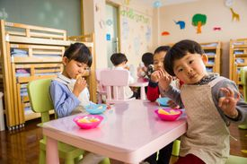 Children in a classroom enjoying snack time.
