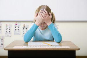 A struggling student at her desk
