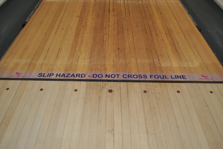 Slip hazard - do not cross the foul line