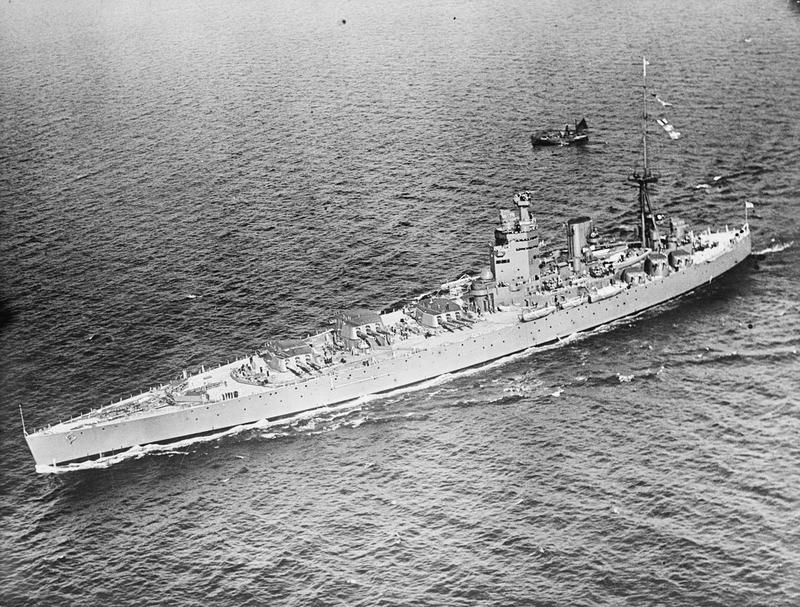 Battleship HMS Nelson at sea with guns trained to port.