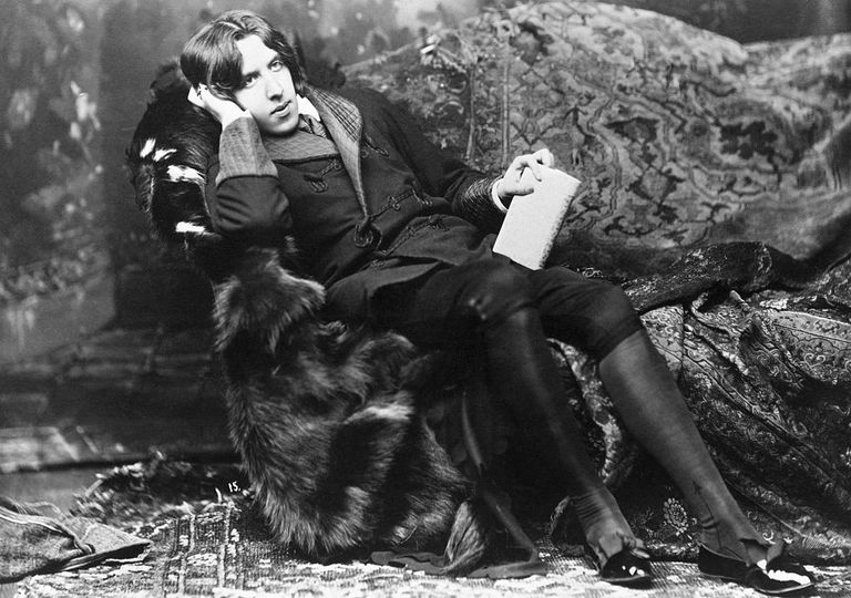 Oscar Wilde relaxing on the divan during his lecture trip through America.