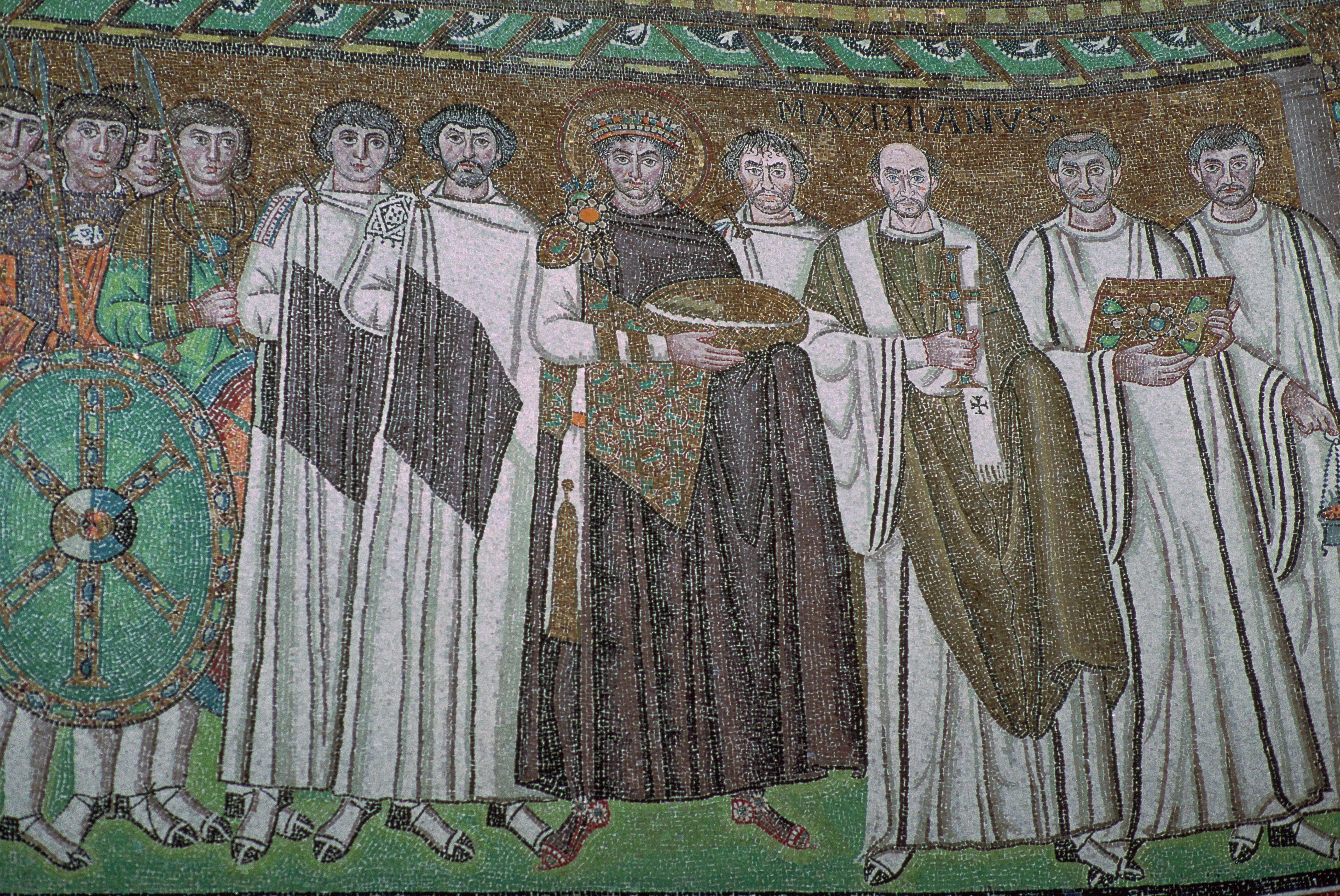 mosaic of a dozen men holding armor, crosses, and a basket