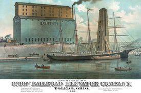 A ship unloading cargo at a grain elevator