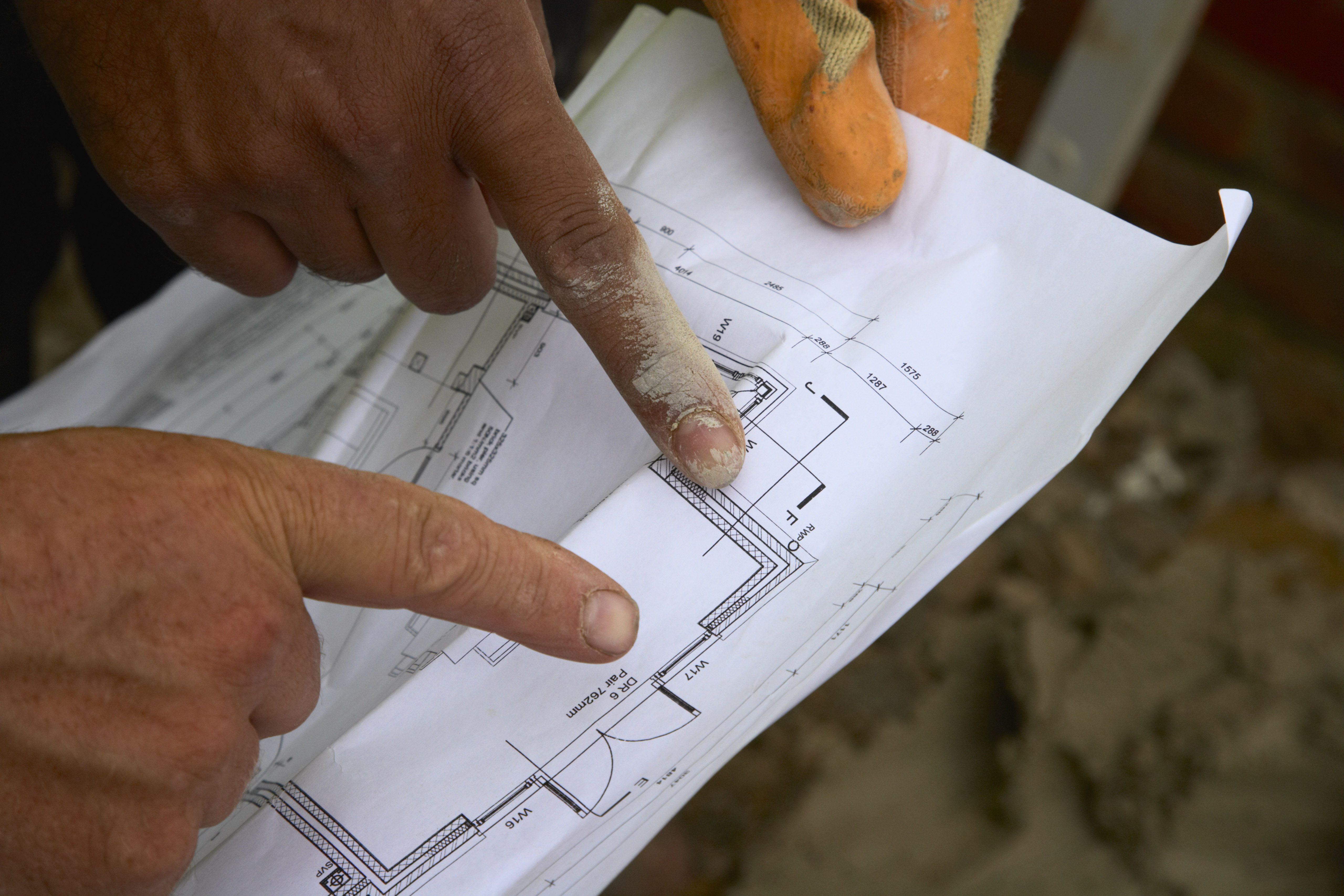 Read And Understand Measurements In House Plans Whether You Are A Homeowner Or Builder Planning Building Workers Looking At All See Their Fingers Pointing Leave The To Builders