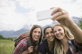 Friends taking selfie near mountains
