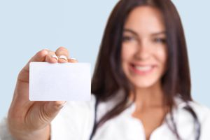 woman holding up blank business card