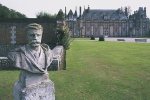 Bust of French writer Guy de Maupassant (1850-1893) in garden of Miromesnil castle, Normandy, France