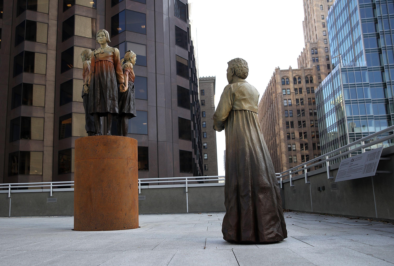 'Comfort Women' Statue In San Francisco on building balcony.