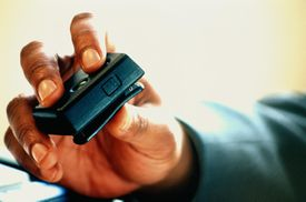 hand holding a pager