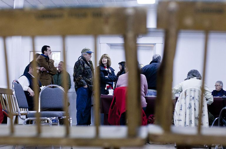New Hampshire voters wait for the polls to open in the nation's first primary on January 10, 2012