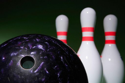Bowling ball and bowling pins (focus on ball in foreground)