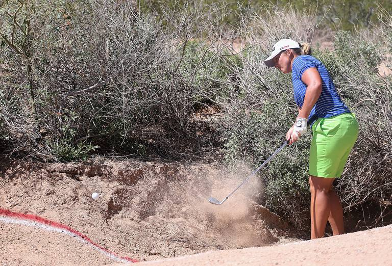 Angela Stanford hitting out of a barranca during LPGA Tour event