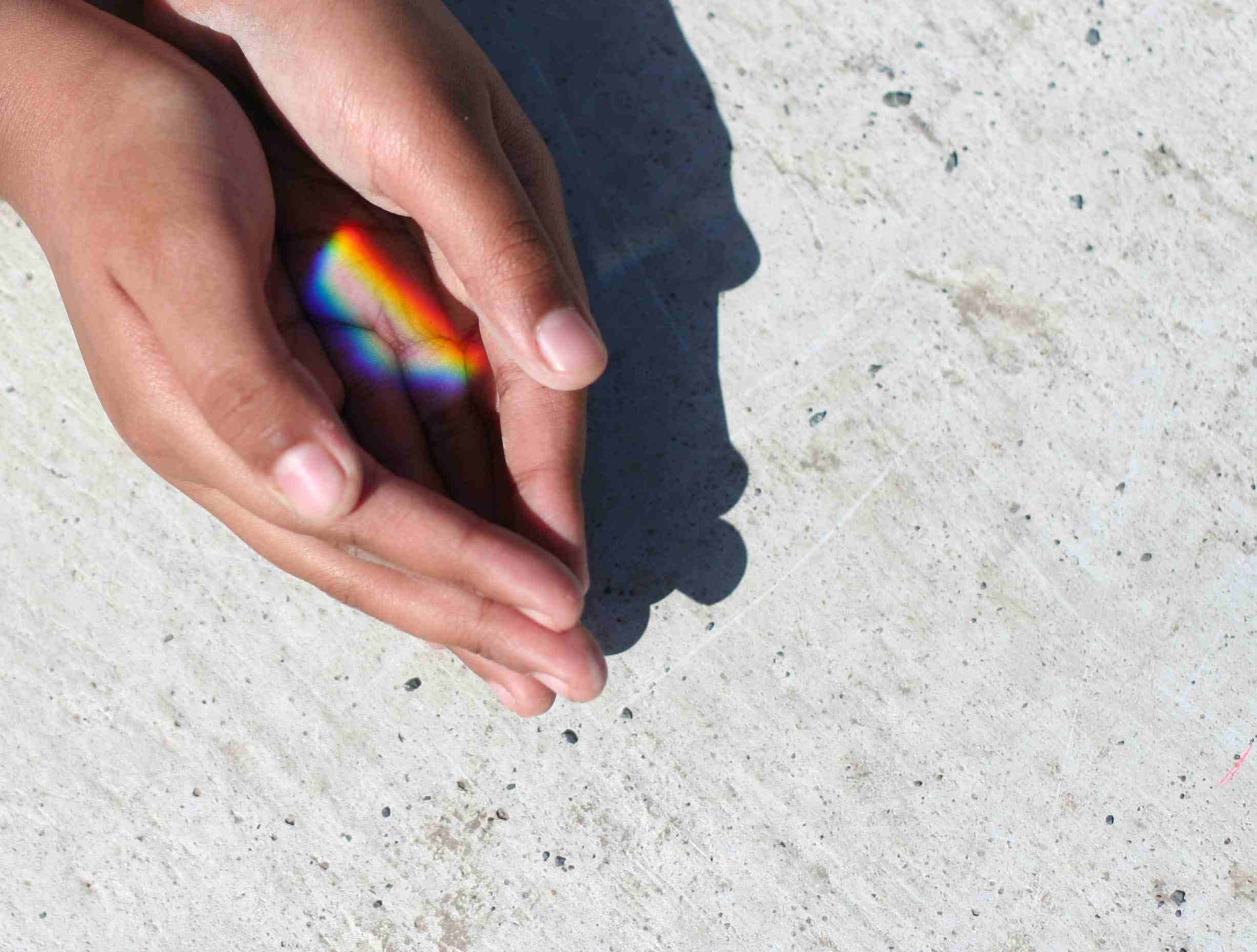 Small rainbow in her hand