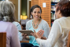 Young woman leads university study group session