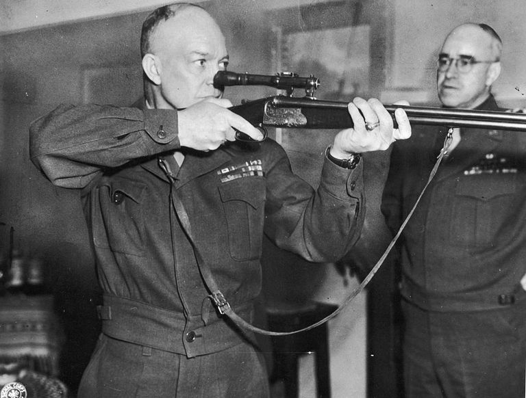 Commanding General of U.S. Army Europe, Dwight D. Eisenhower (1890 - 1969) firing a German-made combination rifle-shotgun with telescopic sight
