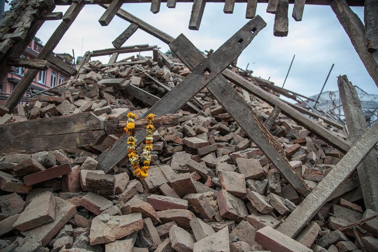 Flowers left by survivors on top of a collapsed building at Basantapur Durbar Square following an earthquake on April 25, 2015 in Kathmandu, Nepal.