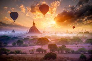 Hot air balloon over plain of Bagan in misty morning, Mandalay, Myanmar