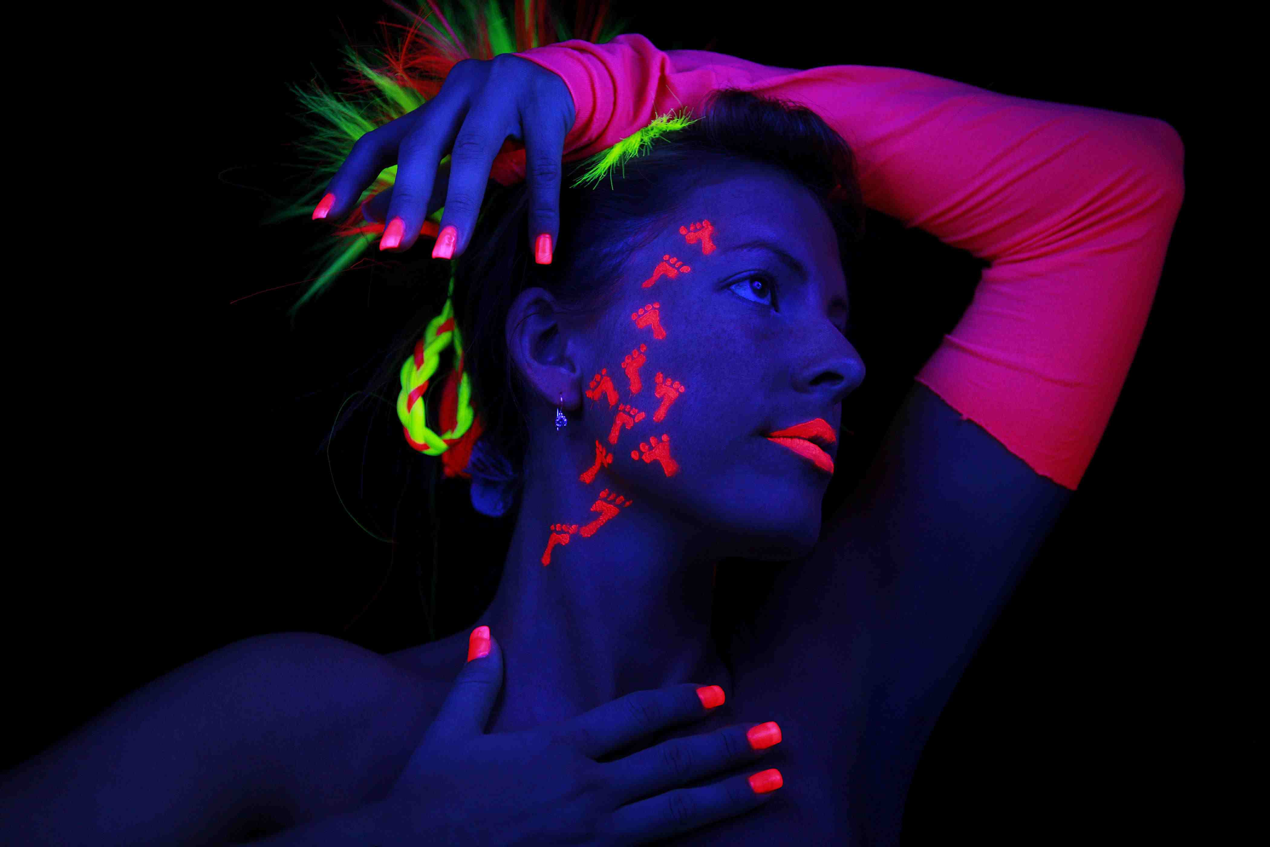 Get fluorescent nail polish, makeup, and temporary tattoos to light up a glow party.