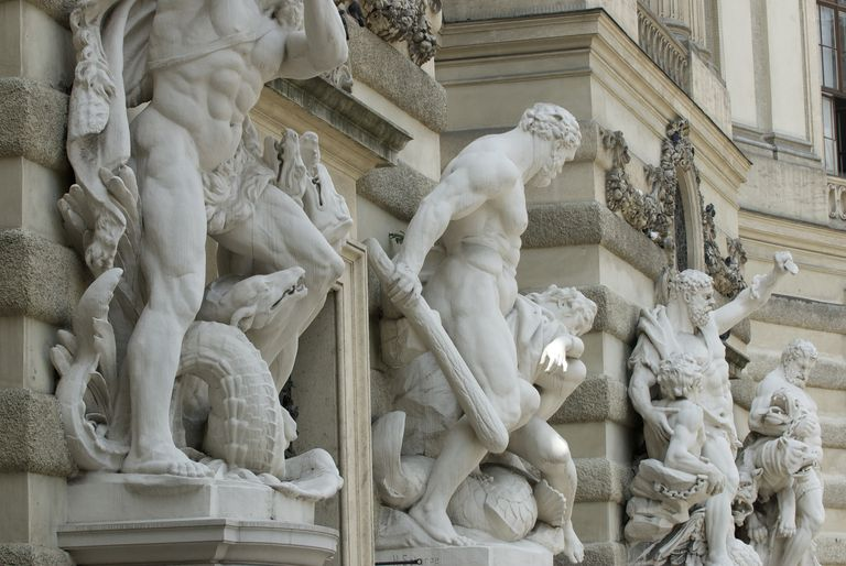 Detail of the entrance to the Imperial Palace in Vienna guarded by grandiose statues of heroic figures