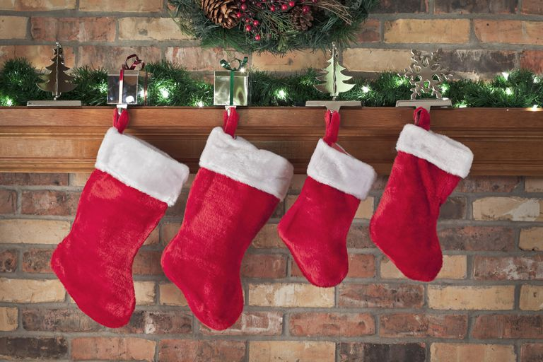 Christmas stockings hanging from a mantle