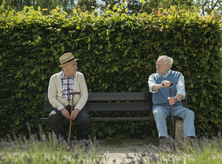 Germany, Two old friends sitting on bench in park