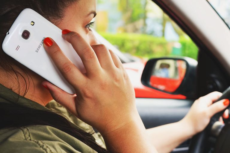 woman driving and talking on cell phone